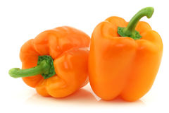 Two fresh orange bell peppers royalty free stock photo