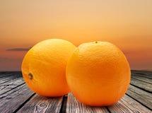 Two fresh oranges on sunset background Stock Photo