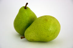 Two fresh pears. On the white background Royalty Free Stock Images