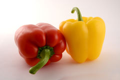 Two fresh peppers. One red fresh pepper and one yellow pepper Royalty Free Stock Photo