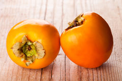 Two fresh persimmons Royalty Free Stock Images