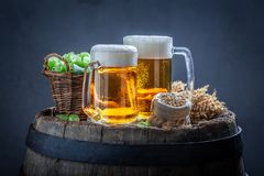 Two fresh pint of beers on old barrel. Two fresh pint of beers on old wooden barrel stock image