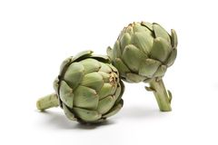 Two fresh raw artichokes Royalty Free Stock Photography