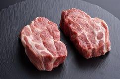 Two fresh raw boneless pork shoulder butt slices Royalty Free Stock Photos