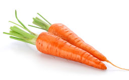 Two fresh raw carrots. Two fresh whole raw carrots on the white background Stock Images