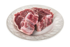 Two Fresh Raw Lamb Chops. A DSLR royalty free image, of fresh raw lamb chops, uncooked fresh healthy, served on a white plate, shot against a white background Royalty Free Stock Photo
