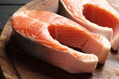 Two fresh raw salmon steaks royalty free stock photography
