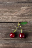 Two fresh red cherries with leaf stock photo