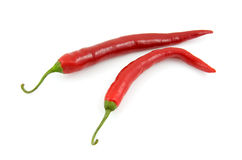 Two fresh red hot peppers Stock Images
