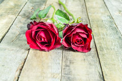 Two fresh red rose on wooden background Royalty Free Stock Photos
