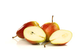 Two fresh red and yellow pears and two halves Stock Photography