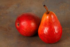 Two fresh ripe organic red bartlett pears Stock Photos