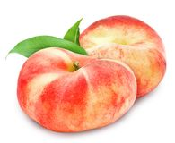 Two fresh ripe peach with leaf. Royalty Free Stock Photography