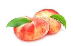 Two fresh ripe peach with leaf. Royalty Free Stock Image
