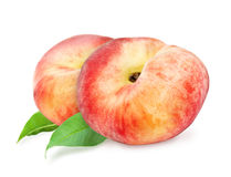 Two fresh ripe peach with leaf. Stock Photo