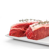 Two fresh rump steaks with thymine twig Royalty Free Stock Photography