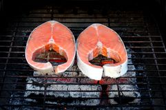 Two fresh salmon steaks on BBQ Royalty Free Stock Photos