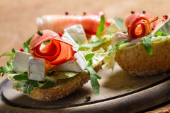 Two fresh sandwiches made of parma ham and brie cheese Stock Photos