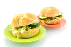Two fresh sandwichtes on plates. Two fresh sandwiches on plates isolated on white background stock photo