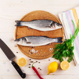 Two fresh sea bass on a white background. Top view. Royalty Free Stock Images