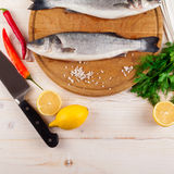 Two fresh sea bass on a white background. Top view. Stock Photos