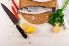 Two fresh sea bass on a white background. Top view. Stock Photo