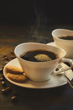 Two fresh servings of hot espresso with cookies Royalty Free Stock Photo