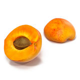 Two fresh slices of apricot isolated on white. One slice with core. 3D Illustration Stock Photo