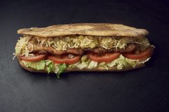Two fresh submarine sandwiches with pickles, cheese, tomatoes, grilled chicken and lettuce royalty free stock photography
