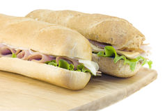 Two fresh subs on cutting board Stock Images