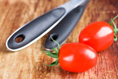 Two fresh tomatoes Stock Images