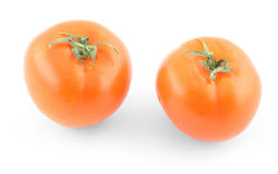 Two fresh tomatoes on white Royalty Free Stock Images