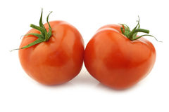 Two fresh tomatoes Stock Photos