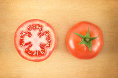 Two fresh tomatoes on wooden cutting board Royalty Free Stock Photo