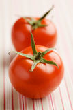 Two fresh vine tomatoes Royalty Free Stock Images