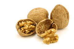Two fresh walnuts and a cracked one Royalty Free Stock Photos