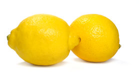 Two fresh whole lemons Royalty Free Stock Image
