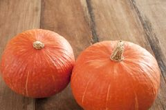 Two fresh whole raw pumpkins Royalty Free Stock Images
