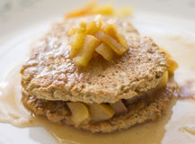 Two freshly baked oatmeal pancakes with apple Royalty Free Stock Photos