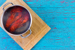 Two Freshly Boiled Whole Lobsters In A Pot Stock Photos