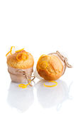 Two freshly made orange muffins stock image