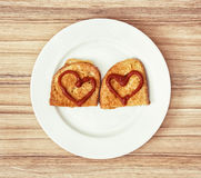 Two fried breads in the egg with hearts of ketchup, valentine fo Royalty Free Stock Photography