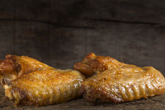 Two fried chicken wings Stock Photos