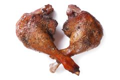 Two fried duck legs isolated on white close up horizontal Royalty Free Stock Photo