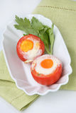 Two fried eggs on fresh tomato royalty free stock image