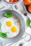Two fried eggs rustic breakfast Royalty Free Stock Photo