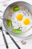 Two fried eggs rustic  breakfast Stock Photo