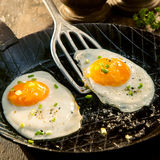 Two fried eggs seasoned with herbs and salt Royalty Free Stock Photo