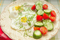 Two fried eggs with vegetables Royalty Free Stock Photo