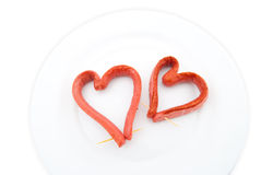 Two Fried sausages in the form of heart Royalty Free Stock Image